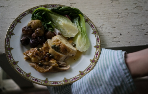 We served our roasted chicken with a simple sauce made with preserved lemon, capers and juice from the bird with bok choy, and potatoes. Any seasonal vegetables would go well with roasted chicken as well as rice or a salad. The sauce works with our previous post as well- the roasted whole chicken.  See the recipe below.